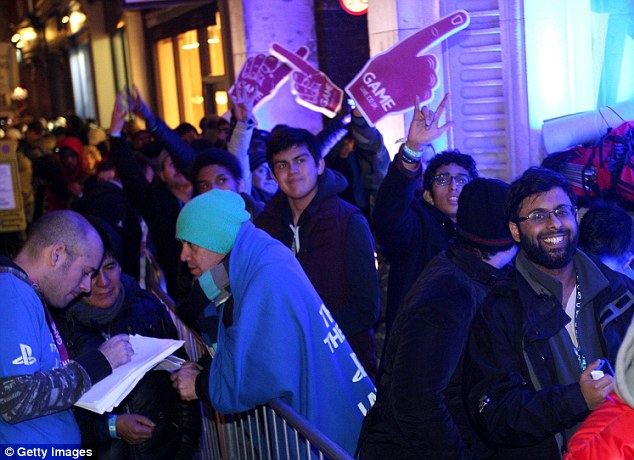 Eager people in line wait for the launch of the PlayStation 4. | Photo courtesy of Getty Images
