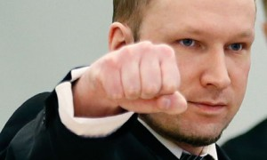 Anders Behring Breivik gestures at the start of the third day of proceedings in Oslo