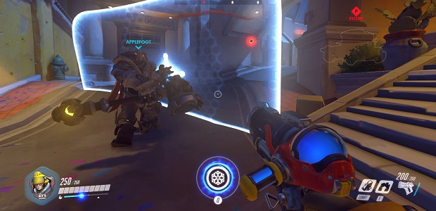 Reinhardt's wall makes him a great tank character. He just doesn't have a gun. He has a big hammer though.