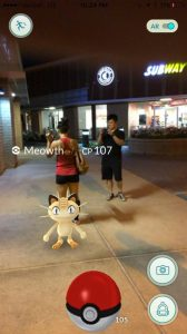 A couple of my friends and I catching a Meowth after our strength training.